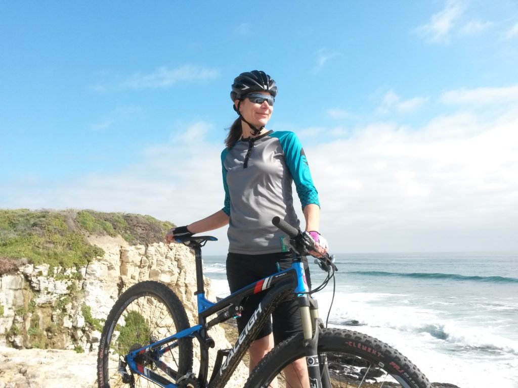 Alicia with mountain bike at beach